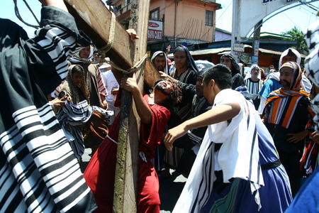 scourge: Cainta, Rizal, Philippines - April 3, 2015 - Penitents reenacting the Passion of Christ. Held on Good Friday as part of celebration of the Holy Week. Editorial
