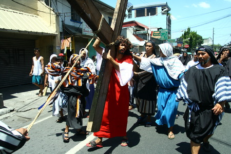 reenacting: Cainta, Rizal, Philippines - April 3, 2015 - Penitents reenacting the Passion of Christ. Held on Good Friday as part of celebration of the Holy Week. Editorial