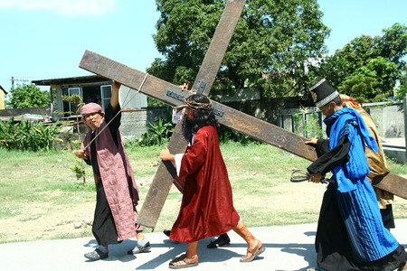 scourging: Cainta, Rizal, Philippines - April 3, 2015 - Reenactment of the Passion of Christ. Held on Good Friday as part of celebration of the Holy Week. Editorial