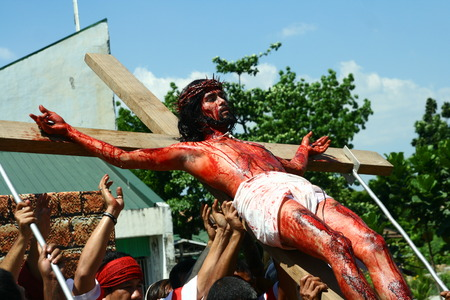 penitence: Cainta, Rizal, Philippines - April 3, 2015 - Reenactment of the Passion of Christ. Held on Good Friday as part of celebration of the Holy Week. Editorial