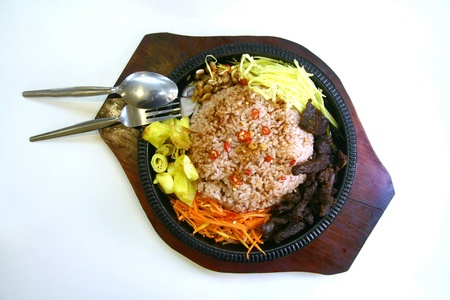 sizzling: Spicy rice with beef abd vegetable on a sizzling plate Stock Photo