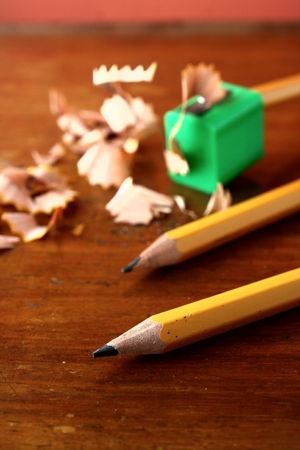 sharpened: Two sharpened pencils and one in a pencil sharpener