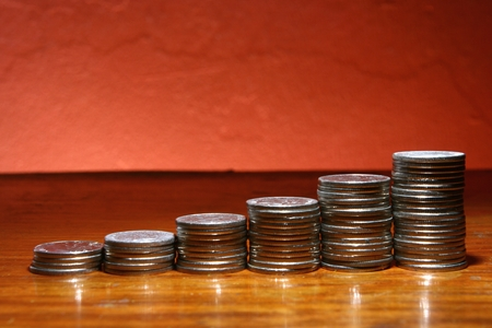 ascending: Pile of coins in ascending form