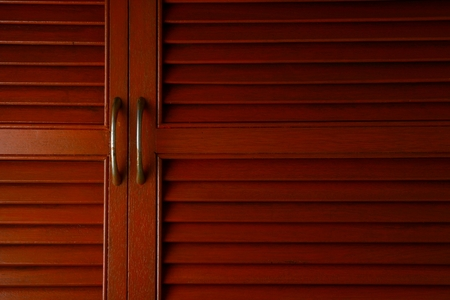 background texture: Wooden cabinet door with metal handle