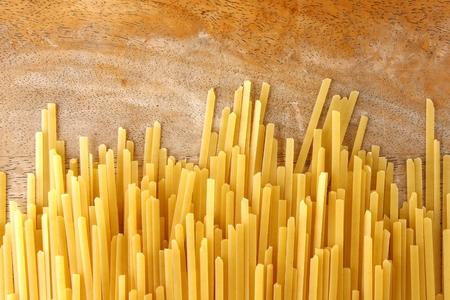 linguine pasta: fresh uncooked strands of linguine pasta