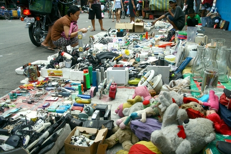 refurbished: Various brand new and refurbished electronics and household items sold in the streets of Manila near the Smokey Mountain in Philippines Asia Editorial