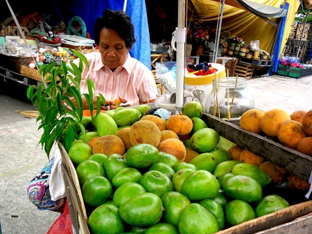 vend: Street vendor selling fruits  in manila city, philippines in asia
