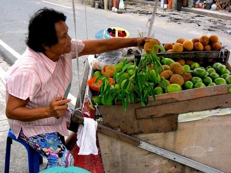 street vendor: Street vendor selling fruits  in manila city, philippines in asia