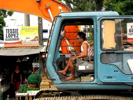 heavy equipment operator: A heavy equipment operator at work in manila city, philippines