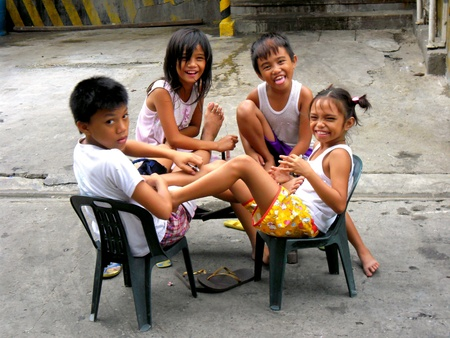 sitted: Young boys and girls smiling and laughing