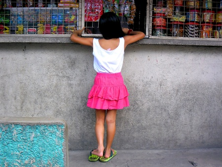Little girl buying at a store