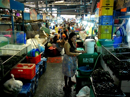 industry: Market vendor selling seafood in cubao, quezon city in the philippines, asia
