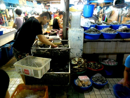 vend: Market vendor selling seafood in cubao, quezon city in the philippines, asia