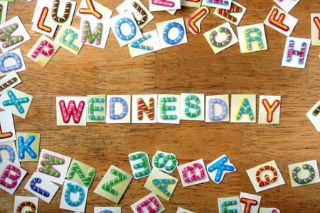backdrop: Random Colorful letters and the word wednesday