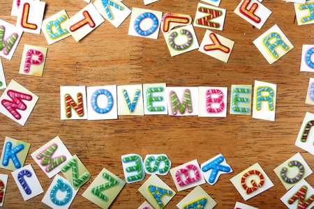 backdrop: Random Colorful letters and the word november