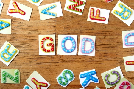 backdrop: Random Colorful letters and the word God