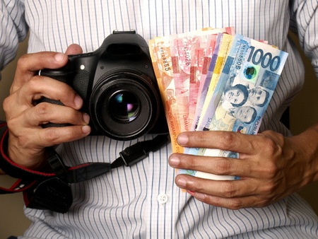 man: Man holding camera and money