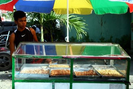 vendor: Peanut vendor in a market