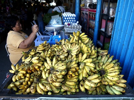 industry: A woman selling bananas in a market Stock Photo