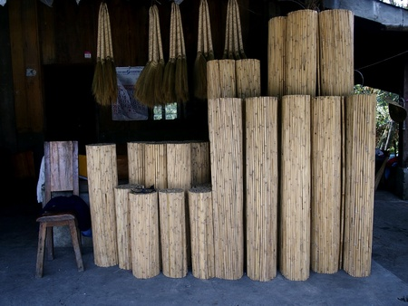 brooms: Window blinds and brooms in a store