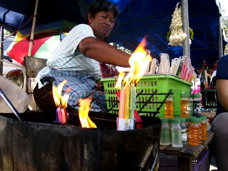 Street vendor selling candles outside of Antipolo church in the Philippines