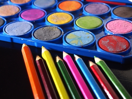 pallette: Pallette of water colors and colored pencils
