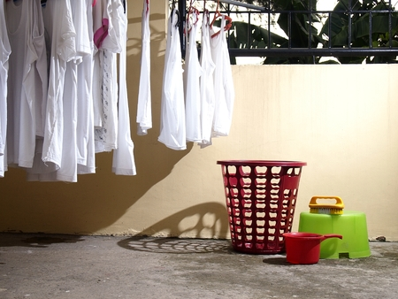 launder: Washed shirts and laundry materials