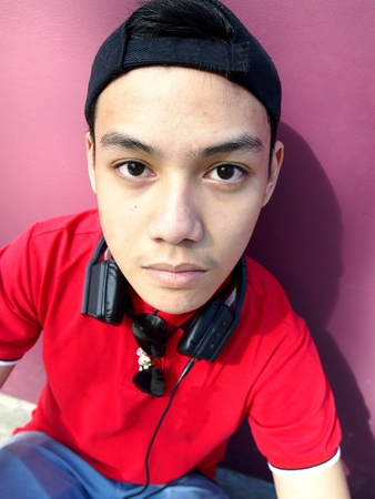 ear phones: Portrait of a teen with a cap on and ear phones
