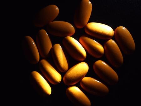 antidote: Orange colored medicinal pills Stock Photo