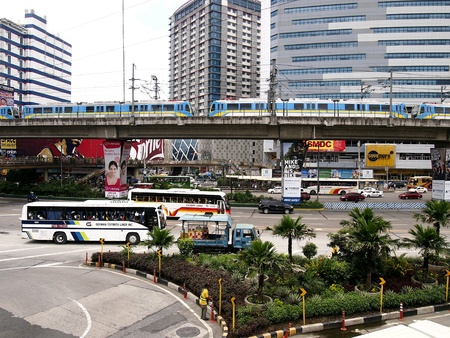 industry: Trains, buses and cars in EDSA, Quezon City, Philippines