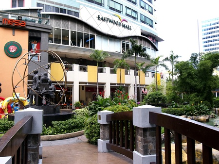 architectural: Rows of bars and restaurants as well as sites and attractions at the Eastwood City in the Philippine