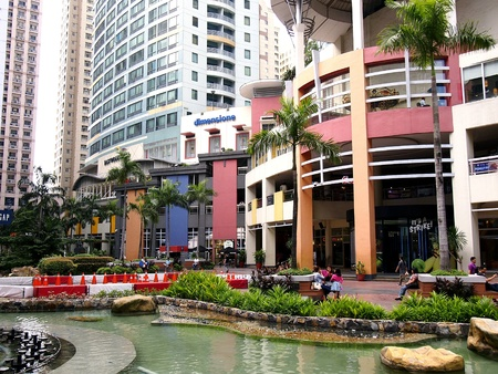 industry: Rows of bars and restaurants as well as sites and attractions at the Eastwood City in the Philippine