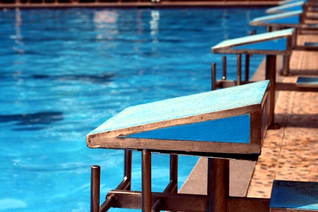 floaters: Diving platforms at a swimming pool Stock Photo