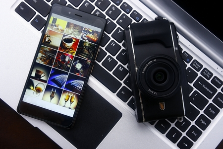 Smartphone,digital mirrorless camera and laptop computer