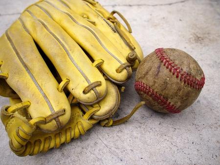 Photo of a baseball gloves and an old baseball Stock Photo