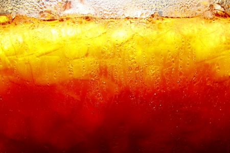Mixed cold iced tea in a glass container Stock Photo
