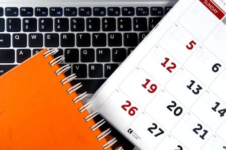 Calendar, notebook and a laptop computer