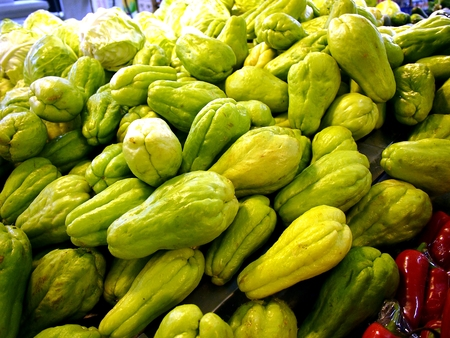 Bunch of fresh Chayote on display at a grocery store