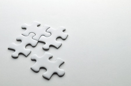 solving: Jigsaw puzzle Stock Photo
