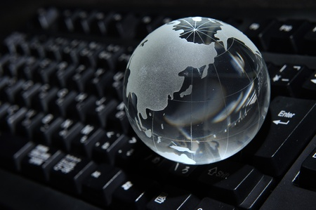 Blue Globe and Computer Keyboard for background photo