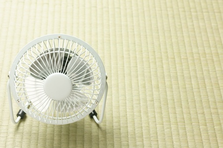 electric fan in front of tatami background photo