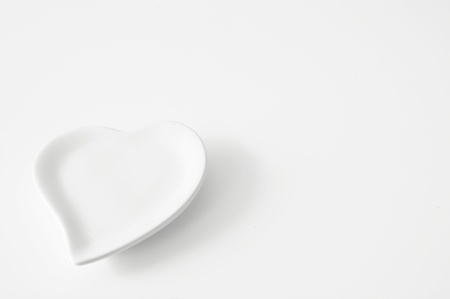 clean arteries: empty white heart plate Stock Photo