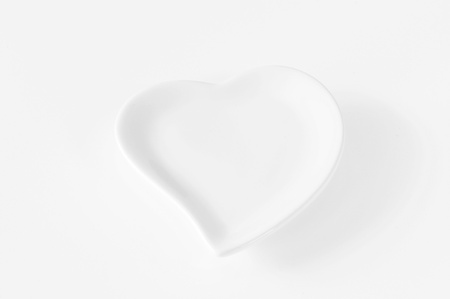 clean arteries: empty red heart plate Stock Photo