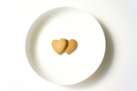 Sweet biscuits in shape of hearts photo