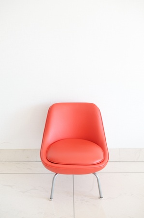 Red Chair to face a blank wall photo