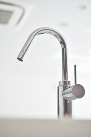 Close up shot of faucet  photo