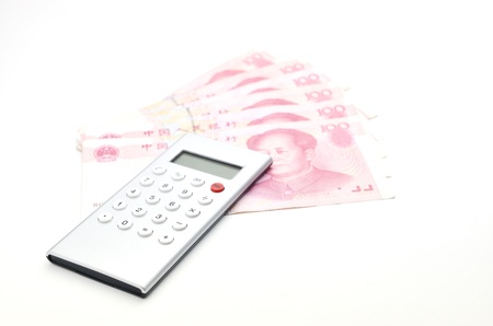 calculator chinese: Calculator and chinese money Stock Photo