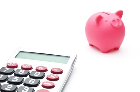 Calculator and piggy bank Stock Photo - 14722070