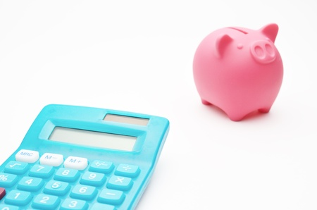Calculator and piggy bank photo