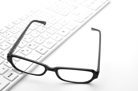 Glasses and keyboard Stock Photo